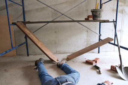 Man on floor with broken scaffolding